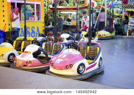 Ferrara Italy August 9 2015: pink bumper car for childrens parked in a luna park at night