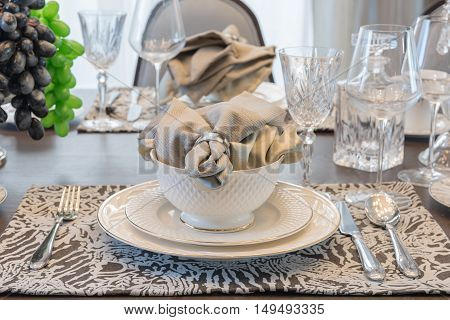 Table Set For Dinner On Dinning Table In Luxury Dinning Room