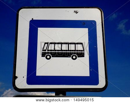 Bus roadsign (bus stop) near asphalt road in city