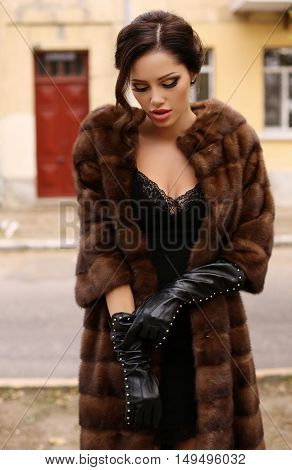 Gorgeous Sensual Woman With Dark Hair In Luxurious Fur Coat And Leather Gloves