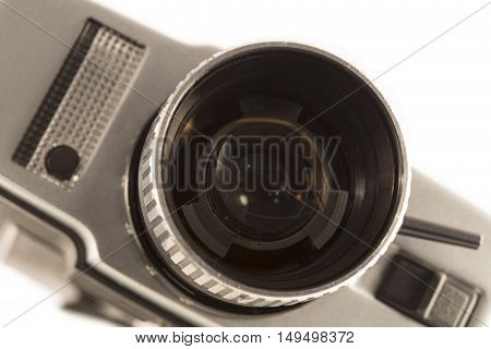 Vintage movie camera close up on white background