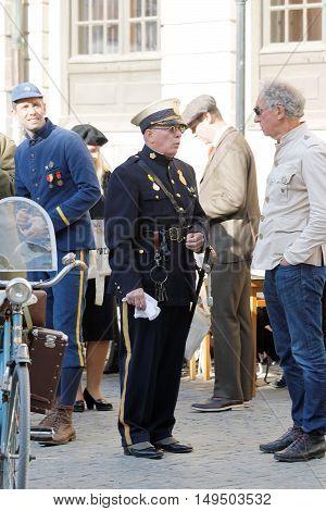STOCKHOLM - SEPT 24 2016: Vintage policeman dressed in old fashioned uniform in the Bike in Tweed event September 24 2016 in Stockholm Sweden