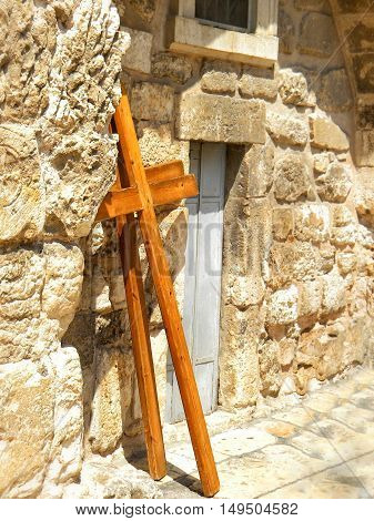Wooden cross and stone monastic cells on roof of Church of the Holy Sepulcher in Jerusalem israel.