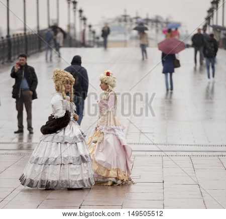 Moscow Russia -September 05 2016: The ladies at the Patriarchal bridge. Man photographs
