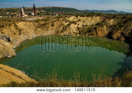 Solotvyno Ukraine - September 29. 2016: Start of ecological disaster - karst failures at the site of one of the mines where salt was mined previously.