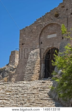 The walls and the main entrance to the old fortress of the ancient Acrocorinth. Peloponnese Greece.