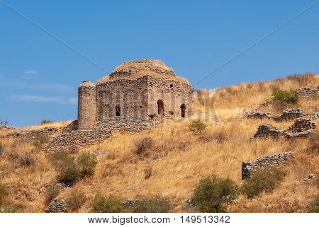Ruins of an ancient temple fortress upper Corinth the inner part is surrounded by old walls on a bright Sunny day. The Peloponnese Greece.