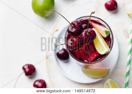 Cherry Limeade, lemonade, cola, cocktail in a tall glass on a white background Top view Copy space