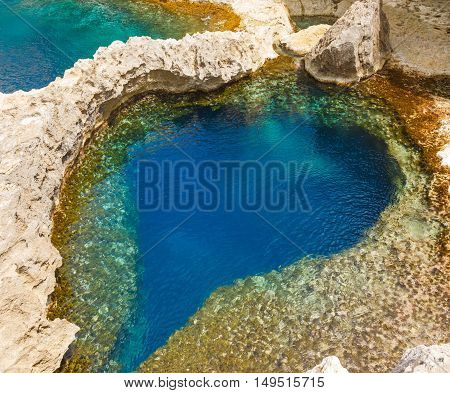 underwater cave in the form of heart at Azure Window in Gozo, Malta