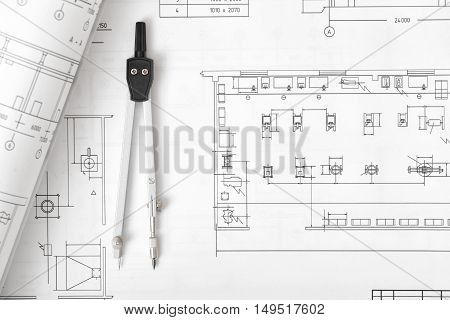 Engineering compass is on building plan. Workplace of architect, constructor, designer in top view. Engineering project. Construction and architecture. Architect drawing. Exact calculation.