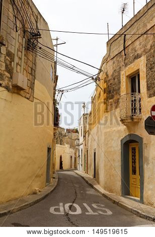 Traditional narrow street in Gozo. Maltese architecture in Rabat, Malta