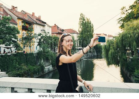 Smiling Tourist On The Background Of Ljubljana Cityscape