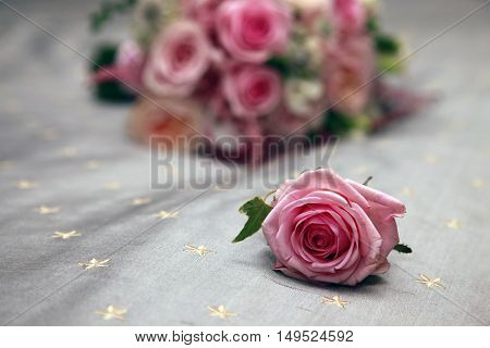 Beautiful wedding bouquet from pink roses .