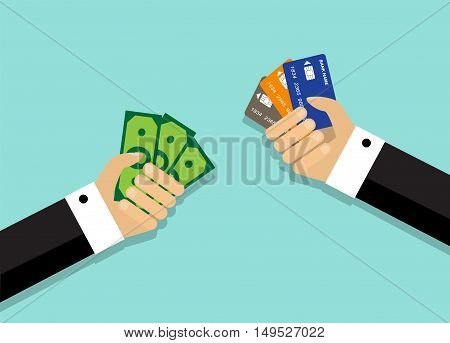 Two arms. One hand holds a credit card, while the other hand holds money