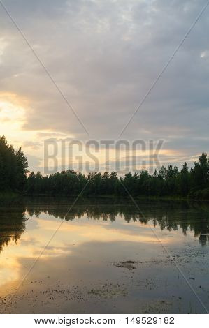 Pond in the countryside in autumn at sunset