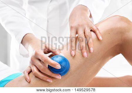 Cellulite, massage thigh. Masseuse massaging thigh .