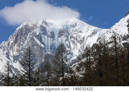 Mont Blanc Summit with clouds from Courmayeur. Italy