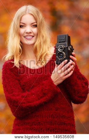 Pretty Smiling Woman With Old Vintage Camera.