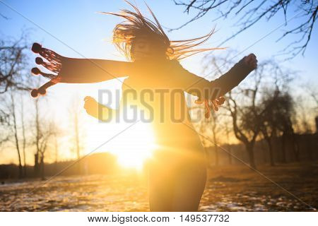 beautiful woman in red scarf dancing in sunset