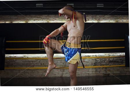 Man Fighter Muay Thai Stand in the ring