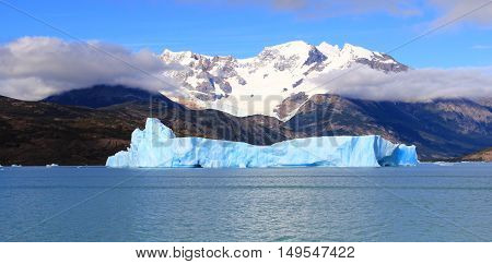 Snow capped mountain and blue iceberg in a lake. El Calafate Patagonia Argentina
