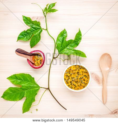 Fresh Passion Fruits Set Up On Wooden Background. Juicy Passion Fruits With Green Leaves  And Passio
