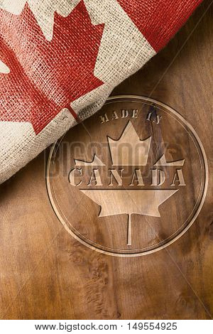 Industrial stamping on the wooden surface of the Made in Canada.