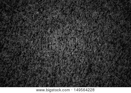 a dark granite texture. Close-up photo for background