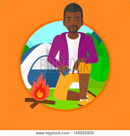 An african-american man kindling a campfire on the background of camping site with tent. Tourist relaxing near campfire. Vector flat design illustration in the circle isolated on background.