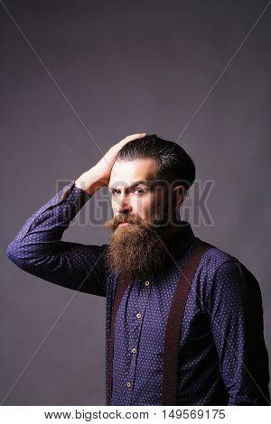 Man Hipster Tidies Hair