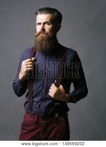 Trendy Man Holds Suspenders
