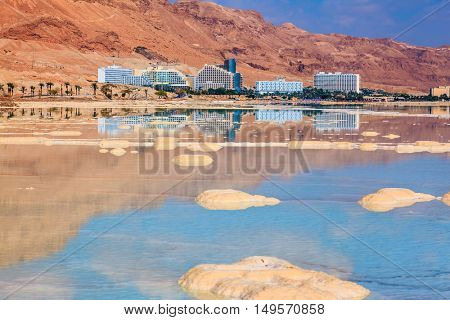 Decrease in water level in the Dead Sea. The evaporated salt acts over a water surface beautiful patterns
