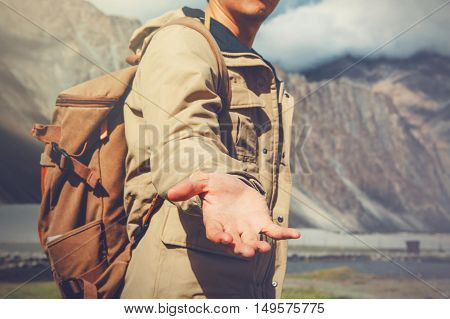 Young Travel Man Lending A Helping Hand In Outdoor Mountain Scenery