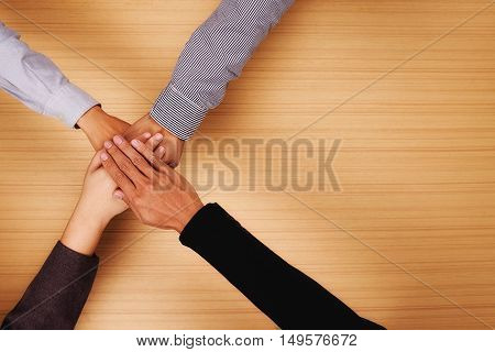 TeamworkBusiness team standing hands together in the office with copy space.Business people joining hands together.People Teamwork hands togetherteamwork online.business teamworkjoin hands together