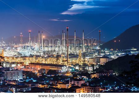 Oil refinery against the blue hour after the sunset