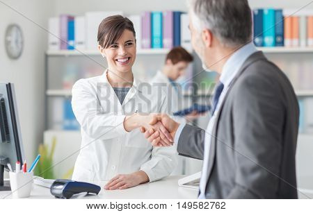 Patient Shaking Hands With A Female Doctor