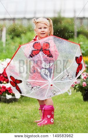 Serious Pensive Pretty Little Girl In Red Raincoat With Umbrella Walking In Park Summer