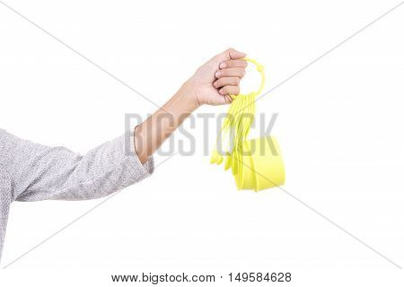 Woman hand holding green measuring cups isolated on white background.