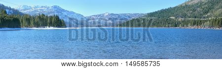 Donner Lake is located in California close to Nevada border and Lake Tahoe. The picture is taken in winter from the east side of the lake.