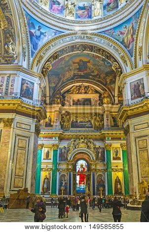SAINT PETERSBURG RUSSIA - APRIL 25 2015: The splendid iconostasis of St Isaac's Cathedral with precious malachite and lazurite columns gilt sculptures carved patterns and stained-glass window on April 25 in Saint Petersburg.