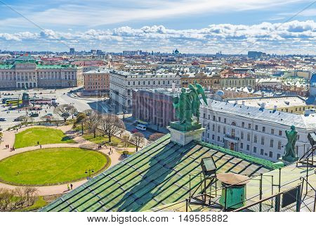 The bronze sculpture of St Matthew the Apostle with Angel on the St Isaac's Cathedral's roof overlooks the St Isaac's Square St Petersburg Russia.