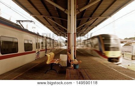 Train station with fast moving trains on arrival
