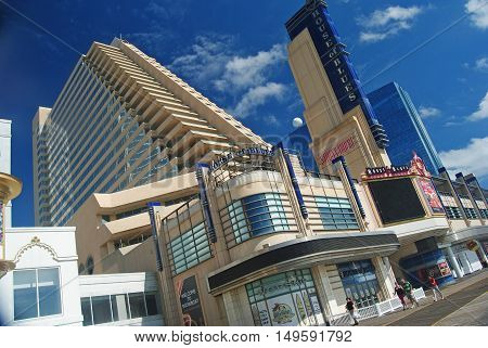 Atlantic City, United States of America - September 7, 2014. House of Blues building on Boardwalk in Atlantic City, with shop windows and people.