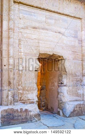 The monumental door frame with ancient hieroglyphic inscriptions and carved patterns in Kom Ombo Temple Egypt.