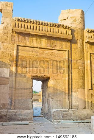 The scenic entrance with preserved reliefs leads to Ineer Hypostyle hall in Egyptian Temple of Kom Ombo.