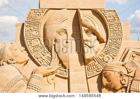 MOSCOW RUSSIA - August 18.2013: Exhibition of sculptures made of sand in Kolomenskoye city park. Sculpture Sword and the Cross