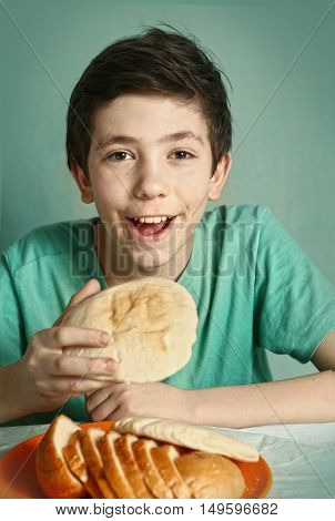 preteen handsome boy with bread close up happy portrait