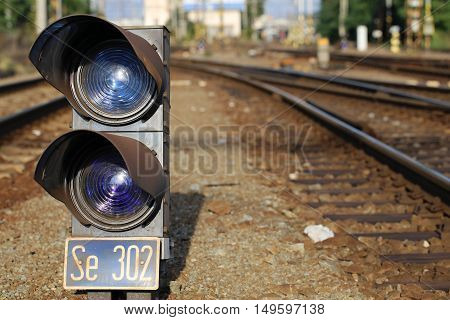 small railway signal in the railyard .
