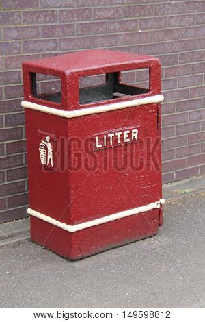 A Large Red Metal Public Litter Bin.