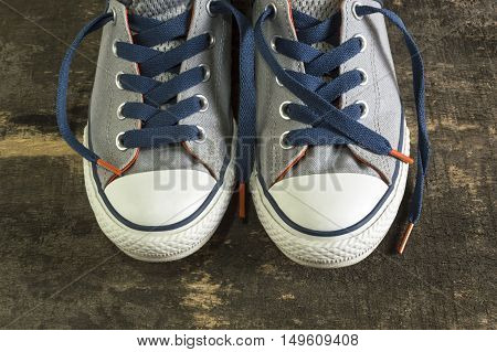 Sneakers on an old wooden surface. Sports shoes